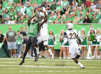 Demetrius Monday of Kent State breaks up a Chase Litton pass intended for Marshall's Tyre Brady on Saturday in Huntington, WV.  MARTY CONLEY/ FOR THE DAILY INDEPENDENT