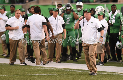 Marshall head coach, Doc Holliday watches his team on Saturday evening against Miami.  MARTY CONLEY/ FOR THE DAILY INDEPENDENT