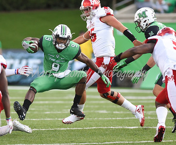 Marshall's Marcel Williams slips through an opening on Saturday evening against Miami.  MARTY CONLEY/ FOR THE DAILY INDEPENDENT