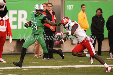 Keion Davis of Marshall crosses the goal line for his second touchdown on Saturday evening against Miami.  MARTY CONLEY/ FOR THE DAILY INDEPENDENT
