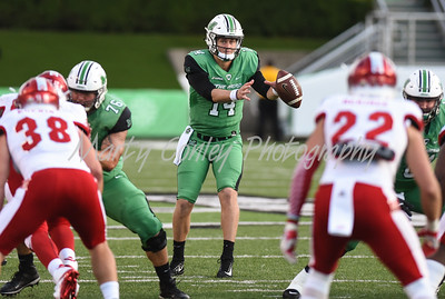 Marshall quarterback, Chase Litton takes a snap on Saturday against Miami.  MARTY CONLEY/ FOR THE DAILY INDEPENDENT