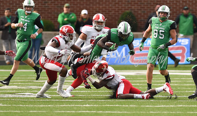 Marshall's Willie Johnson takes a hit on Saturday against Miami.  MARTY CONLEY/ FOR THE DAILY INDEPENDENT