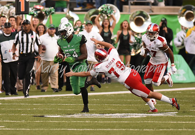 Marshall's Keion Davis breaks free on a kickoff for his second touchdown on the evening against Miami.  MARTY CONLEY/ FOR THE DAILY INDEPENDENT