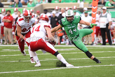 Marshall's Blake Keller pressures Miami quarterback, Gus Ragland on Saturay evening in Huntington.  MARTY CONLEY/ FOR THE DAILY INDEPENDENT