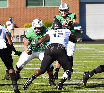 Marshall quarterback, Chase Litton takes a snap on Saturday against Old Dominion.  MARTY CONLEY/ FOR THE DAILY INDEPENDENT