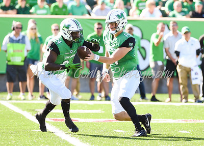 Marshall quarterback, Chase Litton hands off to Keion Davis on Saturday against Old Dominion.  MARTY CONLEY/ FOR THE DAILY INDEPENDENT