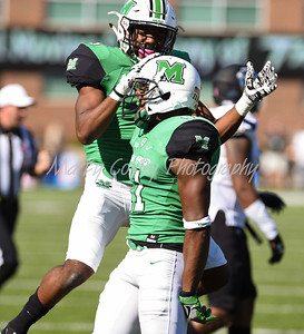 Marshall's Rodney Allen and Chris Jackson celebrate after a big play against Old Dominion on Satuday afternoon.  MARTY CONLEY/ FOR THE DAILY INDEPENDENT