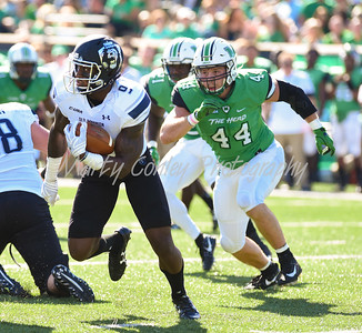 Old Dominion's Melvin Vaugh is pursued by Marshall's Blake Keller on Saturday afternoon in Huntingon, WV.  MARTY CONLEY/ FOR THE DAILY INDEPENDENT
