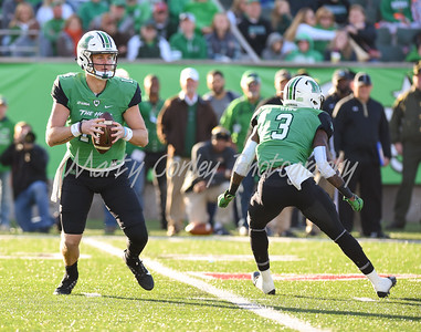 Marshall quarterback, Chase Litton looks for a receiver as teammate, Tyler King blocks on Saturday against Southern Mississippi.  MARTY CONLEY/ FOR THE DAILY INDEPENDENT