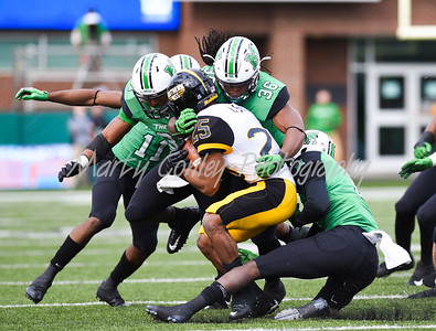 Ito Smith of Southern Mississippi is wrapped up by several members of Marshall, lead by Davon Durant.  MARTY CONLEY/ FOR THE DAILY INDEPENDENT