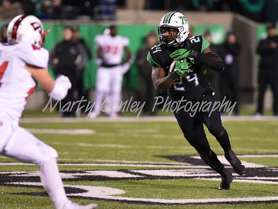 Marshall's Keion Davis looks for a running lane on Saturday against Western Kentucky.  MARTY CONLEY/ FOR THE DAILY INDEPENDENT
