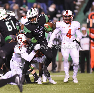 Marshall's Tyler King tries to break away from Western Kentucky defenders on Saturday.  MARTY CONLEY/ FOR THE DAILY INDEPENDENT
