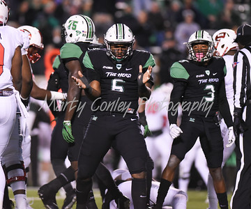 Marquis Couch of Marshall celebrates after a big stop against Western Kentucky on Saturday evening in Huntington.  MARTY CONLEY/ FOR THE DAILY INDEPENDENT
