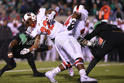 D'Andre Ferby of Western Kentucky is tripped up on Saturday against Marshall.  MARTY CONLEY/ FOR THE DAILY INDEPENDENT