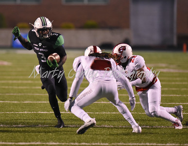 Marshall's Tyler King runs into Western Kentucky defenders on Saturday evening.  MARTY CONLEY/ FOR THE DAILY INDEPENDENT