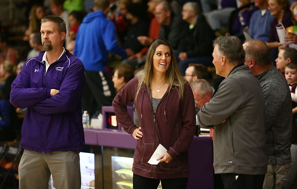12-14-17<br /> Northwestern girls basketball coaches<br /> Jeff Layden, left, Kathie Layden, and Dave Wise, right watch the warmups before the start of the game.<br /> Kelly Lafferty Gerber | Kokomo Tribune