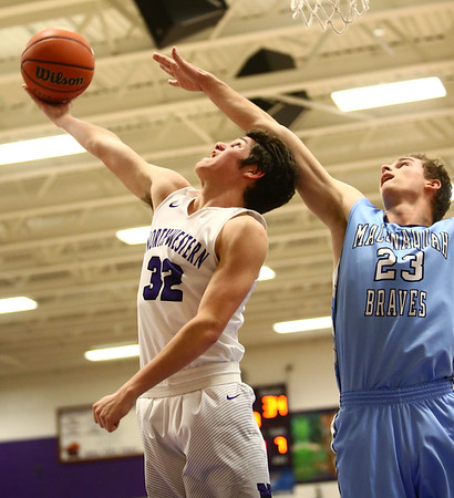 12-15-17<br /> Northwestern vs Maconaquah boys basketball<br /> NW's Caleb Treadway goes to the basket.<br /> Kelly Lafferty Gerber | Kokomo Tribune