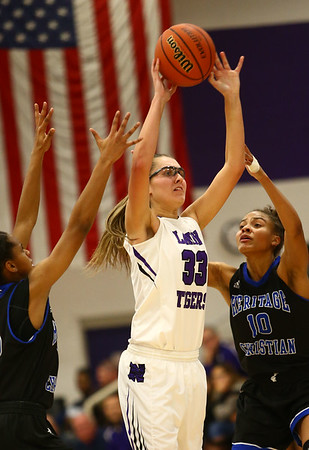 12-14-17<br /> Northwestern vs Heritage Christian girls basketball<br /> Madison Layden throws a pass.<br /> Kelly Lafferty Gerber | Kokomo Tribune