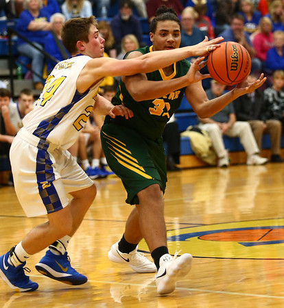 12-8-17<br /> Eastern vs Tri Central boys basketball<br /> Eastern's Antonio Matthews makes a pass.<br /> Kelly Lafferty Gerber | Kokomo Tribune