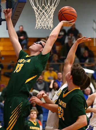 12-8-17<br /> Eastern vs Tri Central boys basketball<br /> Eastern's Nolan Smalley grabs a rebound.<br /> Kelly Lafferty Gerber | Kokomo Tribune