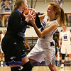 12-14-17<br /> Northwestern vs Heritage Christian girls basketball<br /> HC's Shelby Case and NW's Klair Merrel grapple over the ball.<br /> Kelly Lafferty Gerber | Kokomo Tribune