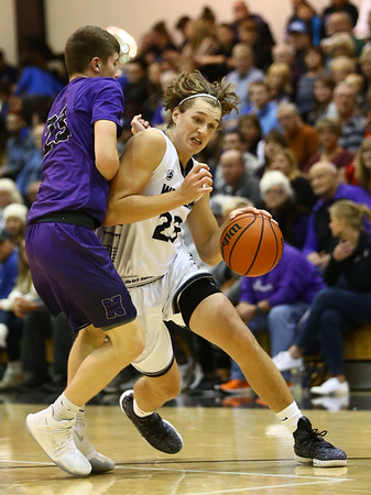 12-1-17<br /> Northwestern vs Western boys basketball<br /> Conner Linn dribbles down the court.<br /> Kelly Lafferty Gerber | Kokomo Tribune