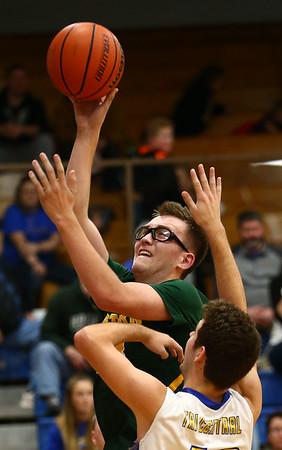 12-8-17<br /> Eastern vs Tri Central boys basketball<br /> Eastern's Nolan Smalley puts up a shot.<br /> Kelly Lafferty Gerber | Kokomo Tribune