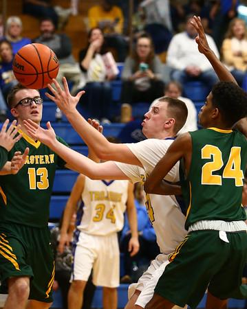 12-8-17<br /> Eastern vs Tri Central boys basketball<br /> TC's Kyler McFarland grabs a rebound.<br /> Kelly Lafferty Gerber | Kokomo Tribune