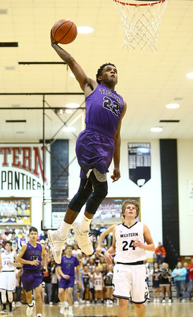 12-1-17<br /> Northwestern vs Western boys basketball<br /> Tayson Parker goes in for a dunk in the last seconds of the game.<br /> Kelly Lafferty Gerber | Kokomo Tribune