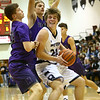12-1-17<br /> Northwestern vs Western boys basketball<br /> Ashton Guyer tries to look past NW defense to the basket.<br /> Kelly Lafferty Gerber | Kokomo Tribune