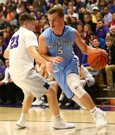 12-15-17<br /> Northwestern vs Maconaquah boys basketball<br /> Mac's Ethan Larason dribbles to the basket.<br /> Kelly Lafferty Gerber | Kokomo Tribune