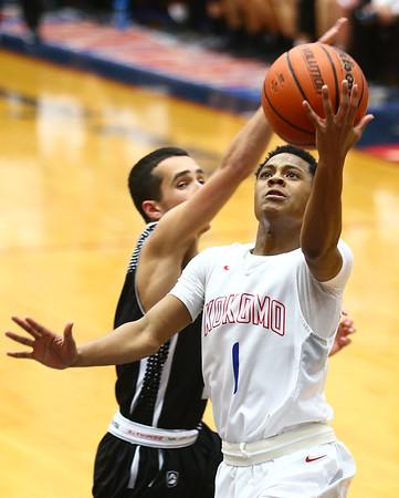 12-5-17<br /> Kokomo vs Western boys basketball<br /> Kokomo's Jayveon White shoots.<br /> Kelly Lafferty Gerber | Kokomo Tribune