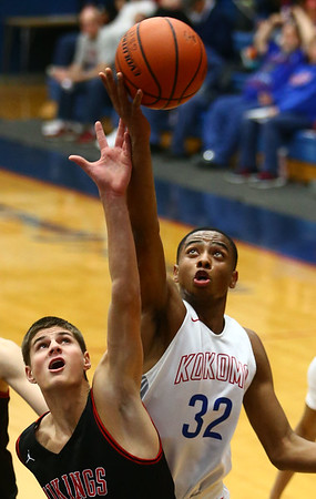 12-16-17<br /> Kokomo vs Huntington North boys basketball<br /> HN's Zach Daugherty and Kokomo's Deonta Chamberlain go after a rebound.<br /> Kelly Lafferty Gerber | Kokomo Tribune