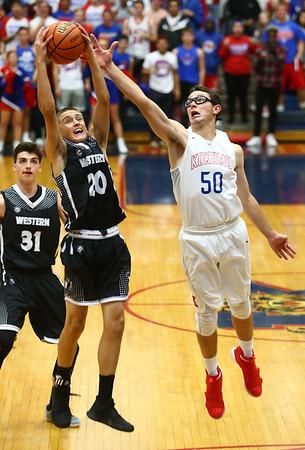 12-5-17<br /> Kokomo vs Western boys basketball<br /> Kyle Sanders catches a wild pass intended for Kokomo's Nate Hemmerich.<br /> Kelly Lafferty Gerber | Kokomo Tribune