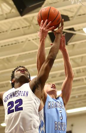 12-15-17<br /> Northwestern vs Maconaquah boys basketball<br /> NW's Tayson Parker and Mac's Chandler Pitts go after a rebound.<br /> Kelly Lafferty Gerber | Kokomo Tribune
