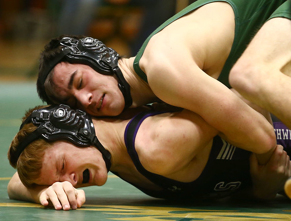 12-28-17<br /> Eastern wrestling classic<br /> Eastern's Isaac Maurer takes down NW's Brady Henry in the 152.<br /> Kelly Lafferty Gerber | Kokomo Tribune