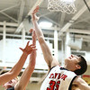 12-12-17<br /> Taylor vs Alexandria-Monroe boys basketball<br /> Preston Pearce goes up for a rebound.<br /> Kelly Lafferty Gerber | Kokomo Tribune