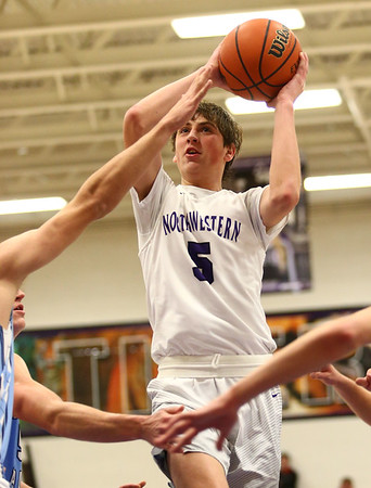 12-15-17<br /> Northwestern vs Maconaquah boys basketball<br /> Ben Harris shoots.<br /> Kelly Lafferty Gerber | Kokomo Tribune
