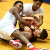 12-16-17<br /> Kokomo vs Huntington North boys basketball<br /> Kokomo's Shemar Robinson and Jayveon White grapple with HN's Zach Daugherty over the ball.<br /> Kelly Lafferty Gerber | Kokomo Tribune