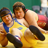 12-28-17<br /> Eastern wrestling classic<br /> Taylor's Cory Dillman takes down TC's Nash Reeves in the 220.<br /> Kelly Lafferty Gerber | Kokomo Tribune