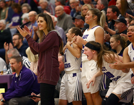 12-14-17<br /> Northwestern girls basketball coaches<br /> Head coach Kathie Layden applauds one of her players (Taylor Boruff) as Boruff was sinking almost every shot she made.<br /> Kelly Lafferty Gerber | Kokomo Tribune