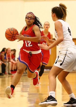 12-2-17<br /> Kokomo vs Peru girls basketball<br /> Tevin Deckard dribbles down the court.<br /> Kelly Lafferty Gerber | Kokomo Tribune