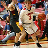 12-12-17<br /> Taylor vs Alexandria-Monroe boys basketball<br /> Cassius Kelley-Smalley dribbles to the basket.<br /> Kelly Lafferty Gerber | Kokomo Tribune