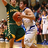 2-7-17<br /> Tipton vs Eastern boys basketball<br /> Tipton's Kellen Woods dribbles to the basket.<br /> Kelly Lafferty Gerber | Kokomo Tribune