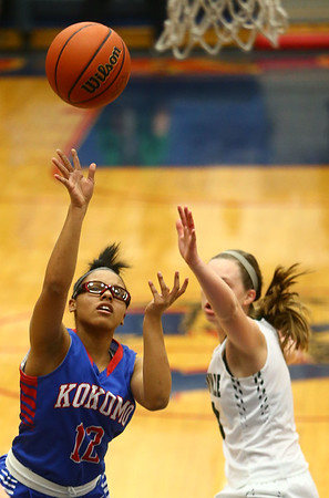 2-3-17<br /> Kokomo vs Zionsville girls basketball<br /> Kokomo's Tevin Deckard shoots.<br /> Kelly Lafferty Gerber | Kokomo Tribune