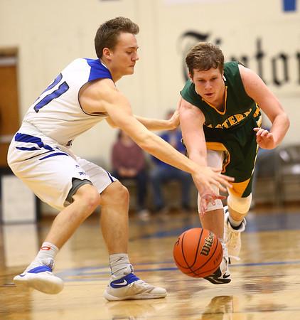 2-7-17<br /> Tipton vs Eastern boys basketball<br /> Tipton's Tyler Slack and Eastern's Draeden Morris Graber go after a loose ball.<br /> Kelly Lafferty Gerber | Kokomo Tribune