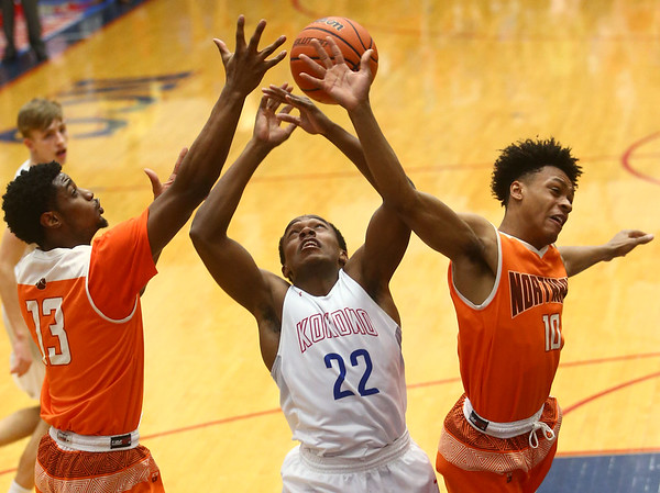 2-24-17<br /> Kokomo vs Fort Wayne Northrop boys basketball<br /> Brevin Beard, center, and Northrop's Tyj Cobb and Richard Robertson go after a rebound.<br /> Kelly Lafferty Gerber | Kokomo Tribune