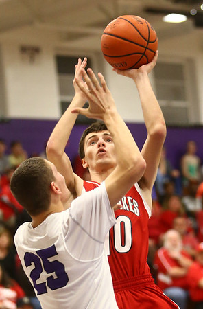 2-17-17<br /> Northwestern defeats Twin Lakes 56-48 for the Hoosier Conference Championship<br /> TL's Anton Ademi goes up for a shot.<br /> Kelly Lafferty Gerber | Kokomo Tribune
