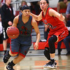 2-22-17<br /> IUK vs Rio Grande girls basketball<br /> IUK's Deja Felder dribbles around Rio Grande's Jasmine Smith.<br /> Kelly Lafferty Gerber | Kokomo Tribune