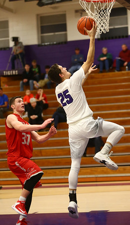 2-2-17<br /> Northwestern vs West Lafayette boys basketball<br /> NW's Tyler Foster goes for a layup.<br /> Kelly Lafferty Gerber | Kokomo Tribune